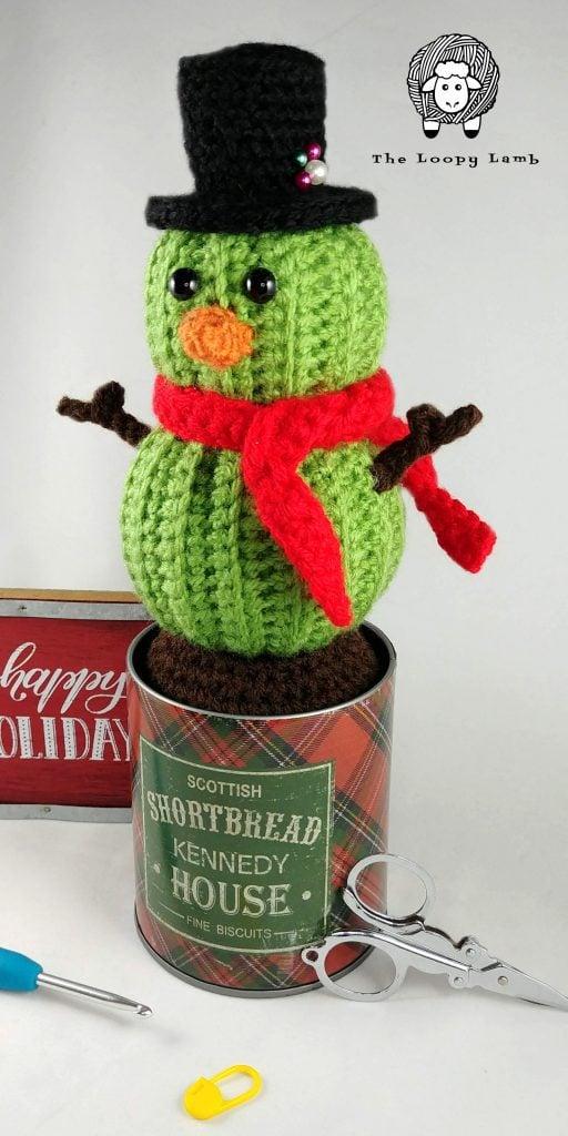 Stanley the Crochet Snowman - Amigurumi Christmas Cactus in a shortbread tin pot