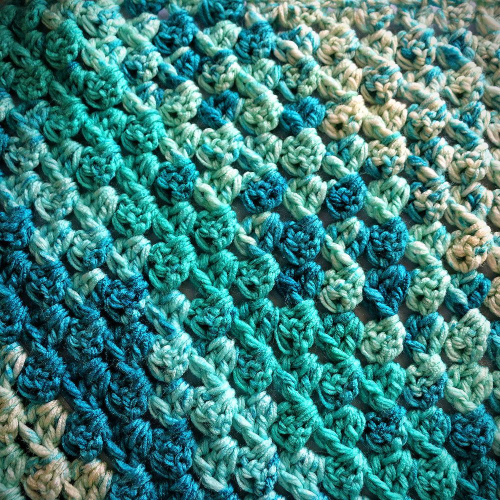 close up of texture of the once in a blue moon triangle scarf