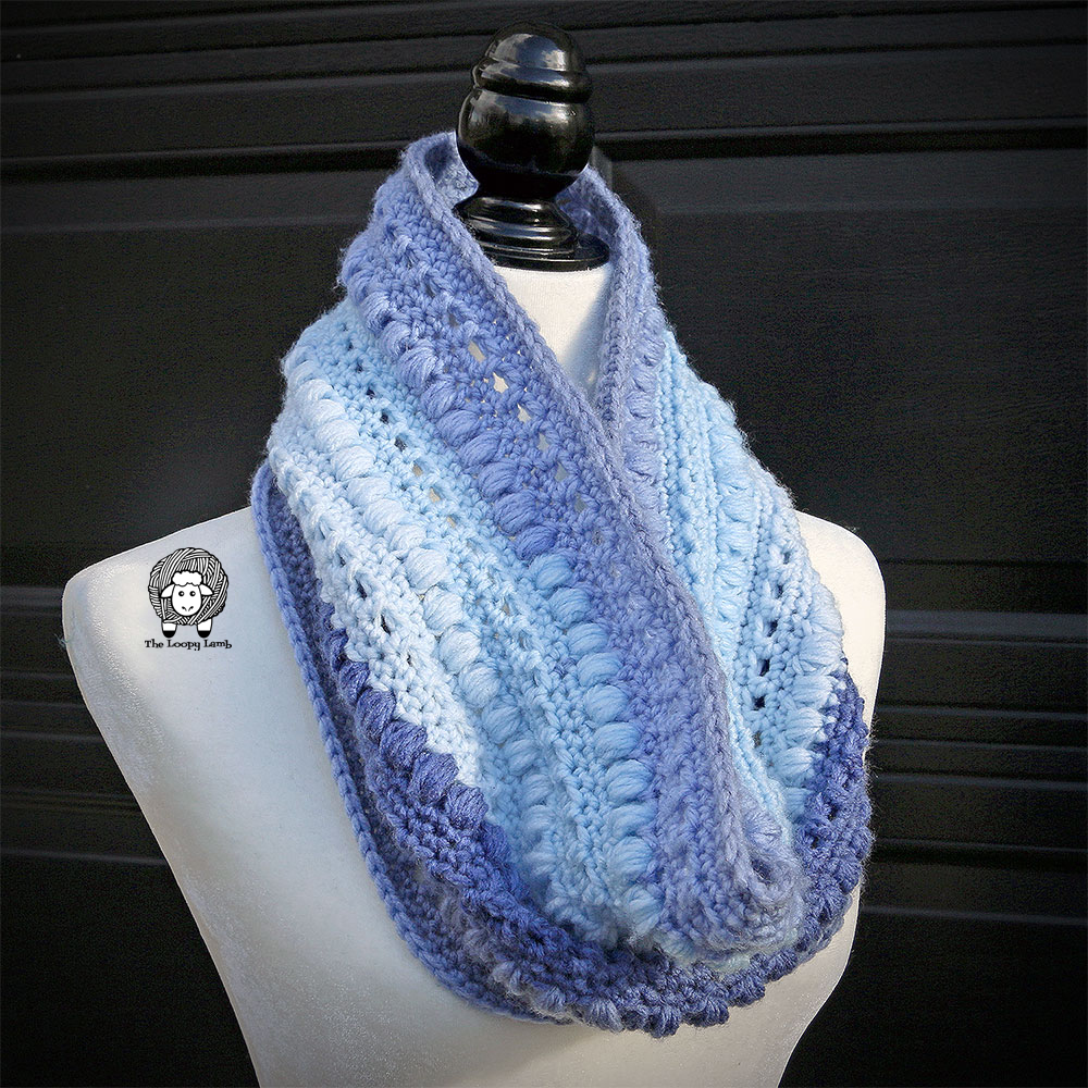 Blue cowl on a mannquinn made with this free crochet cowl pattern