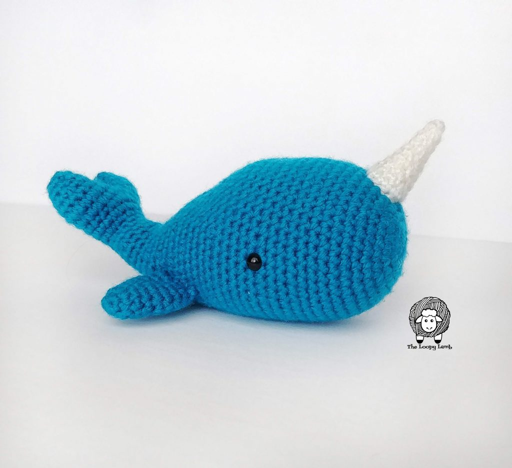 Crochet Narwhal made in blue with a white horn