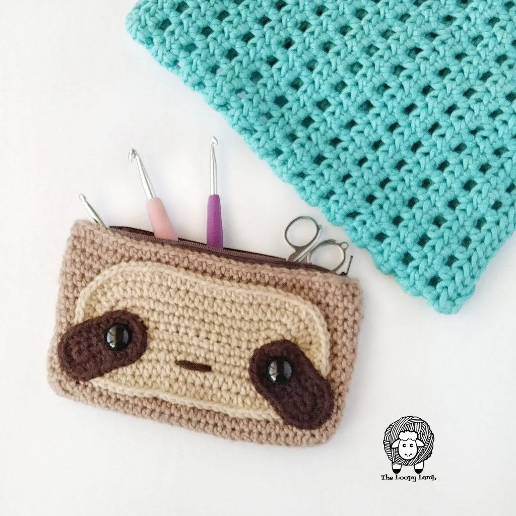 sloth hook case with crochet hooks coming out of it.