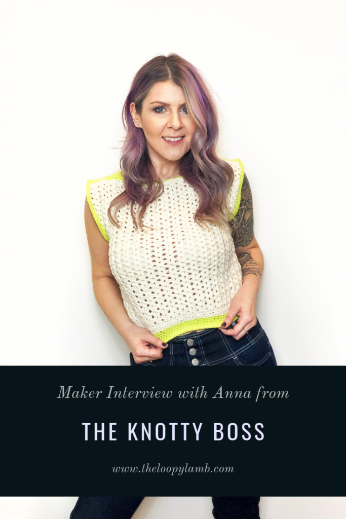 Anna from The Knotty Boss wearing a crochet top.