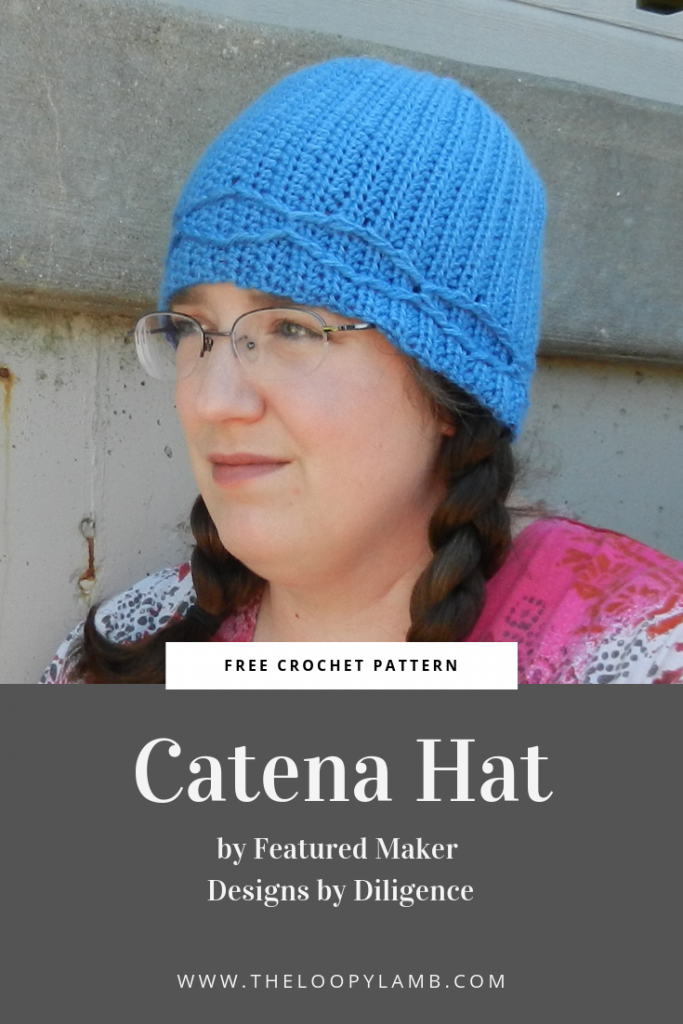 Woman in glasses wearing a blue crochet Catena Hat made with this easy crochet hat pattern.