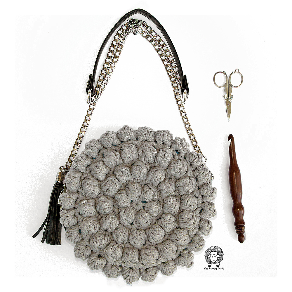 Modern crochet purse made with this free crochet purse pattern by the loopy lamb