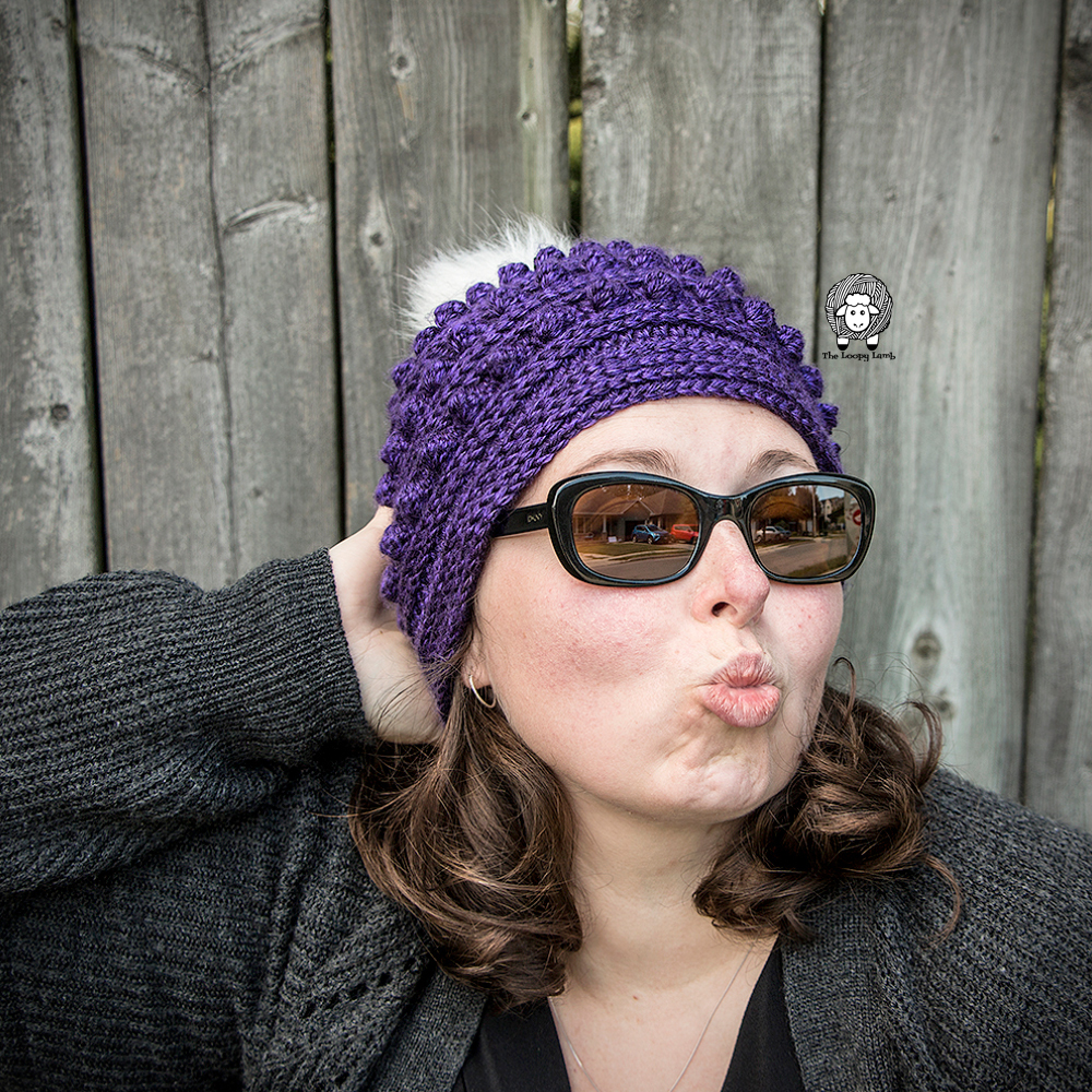 girl acting silly wearing The Aeipathy Beanie, a crochet hat pattern from The Loopy Lamb