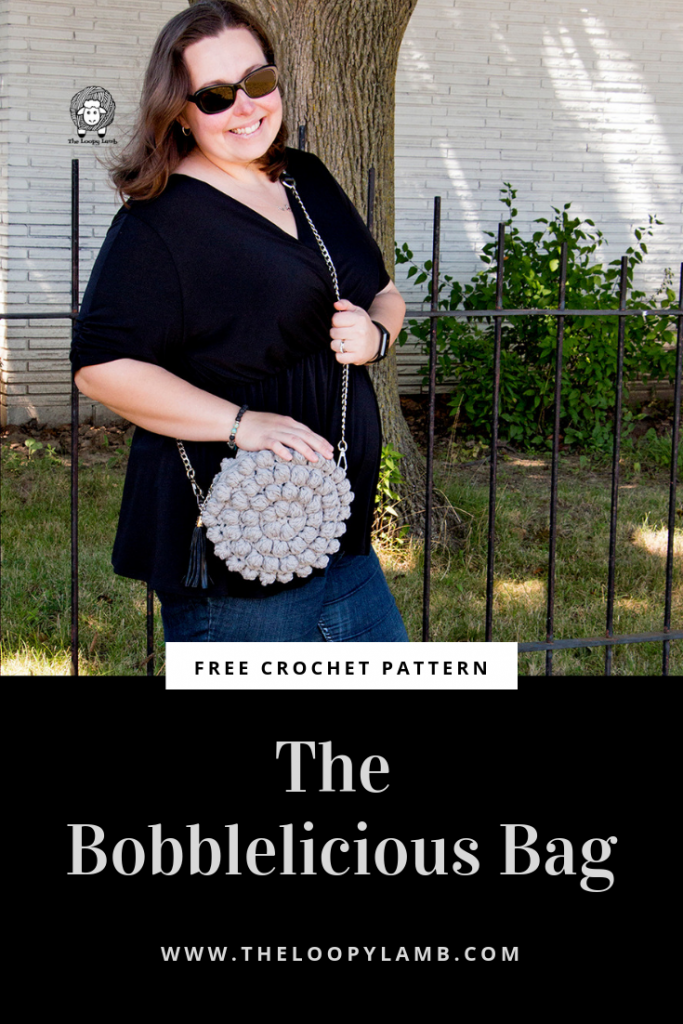 "The Bobblelicious Bag is a free crochet purse pattern features chunky bobble stitches and a surprise pop of colour. The chain style strap gives it a professional touch that will make your friends wonder ""where did she buy that bag?"".  Check out the free crochet pattern for the Bobblelicious Baf from The Loopy Lamb  #bobblestitch #purse #bobblestitchbag #bag #crochetpattern #freecrochetpattern #freepattern #bobbleliciousbag #Crochetpurse #crochetbag"
