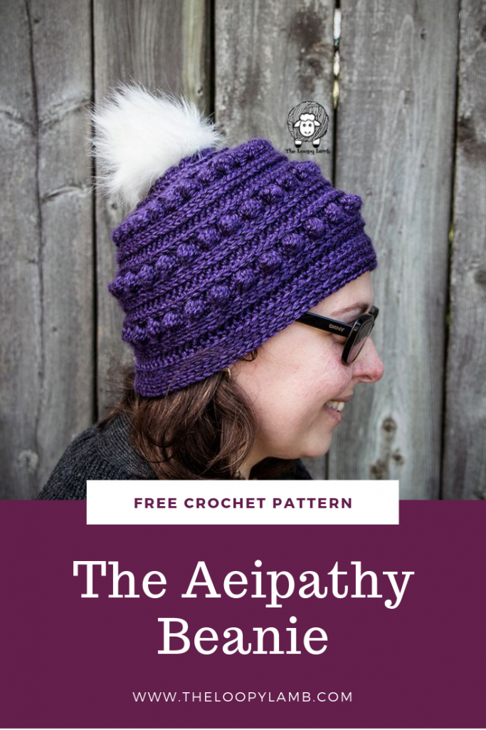 Woman wearing sunglasses wearing a purple Aeipathy Beanie made with this free crochet beanie pattern