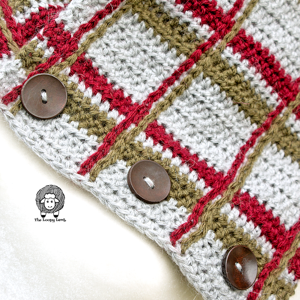 close up of the buttons on the crochet plaid cowl.