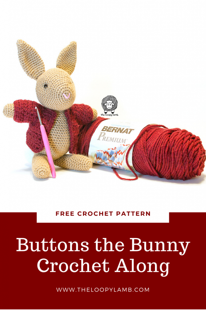 Buttons the Bunny sitting next to a skein of Bernat Premium yarn which is used in this free crochet along pattern.