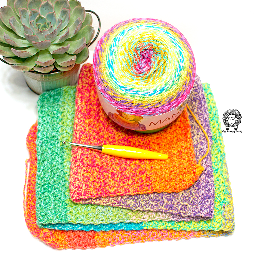 crochet project with cake of lion brand mandala tweed sitting on top to show different in colours.