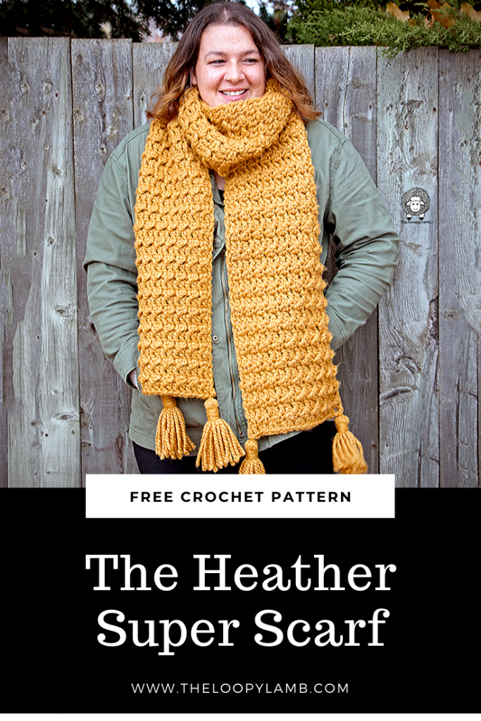 Woman wearing a yellow crochet scarf made with this free crochet scarf pattern