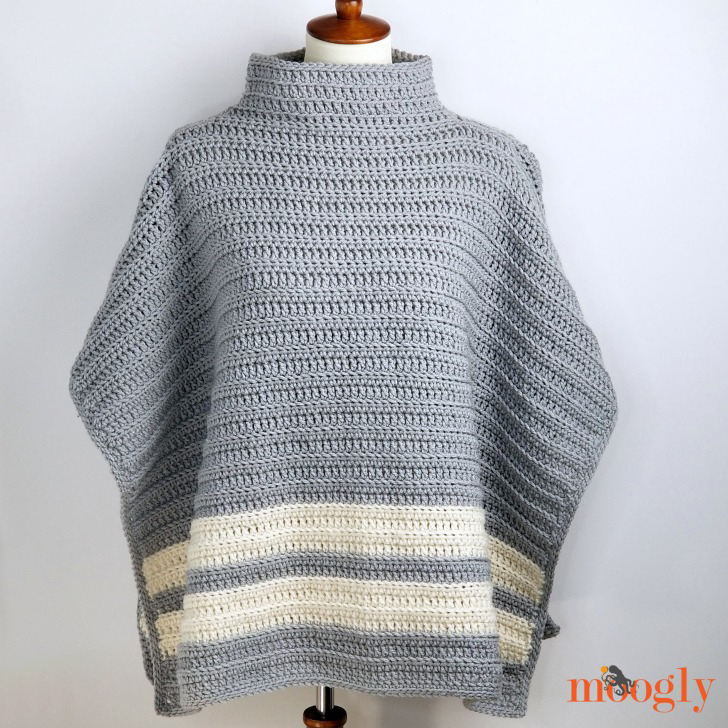 grey and white striped poncho on a mannequin made with a free crochet poncho pattern
