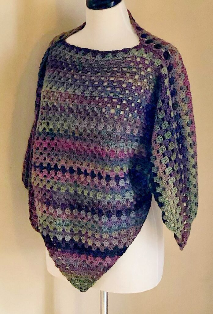 Striped poncho worn by a mannequin