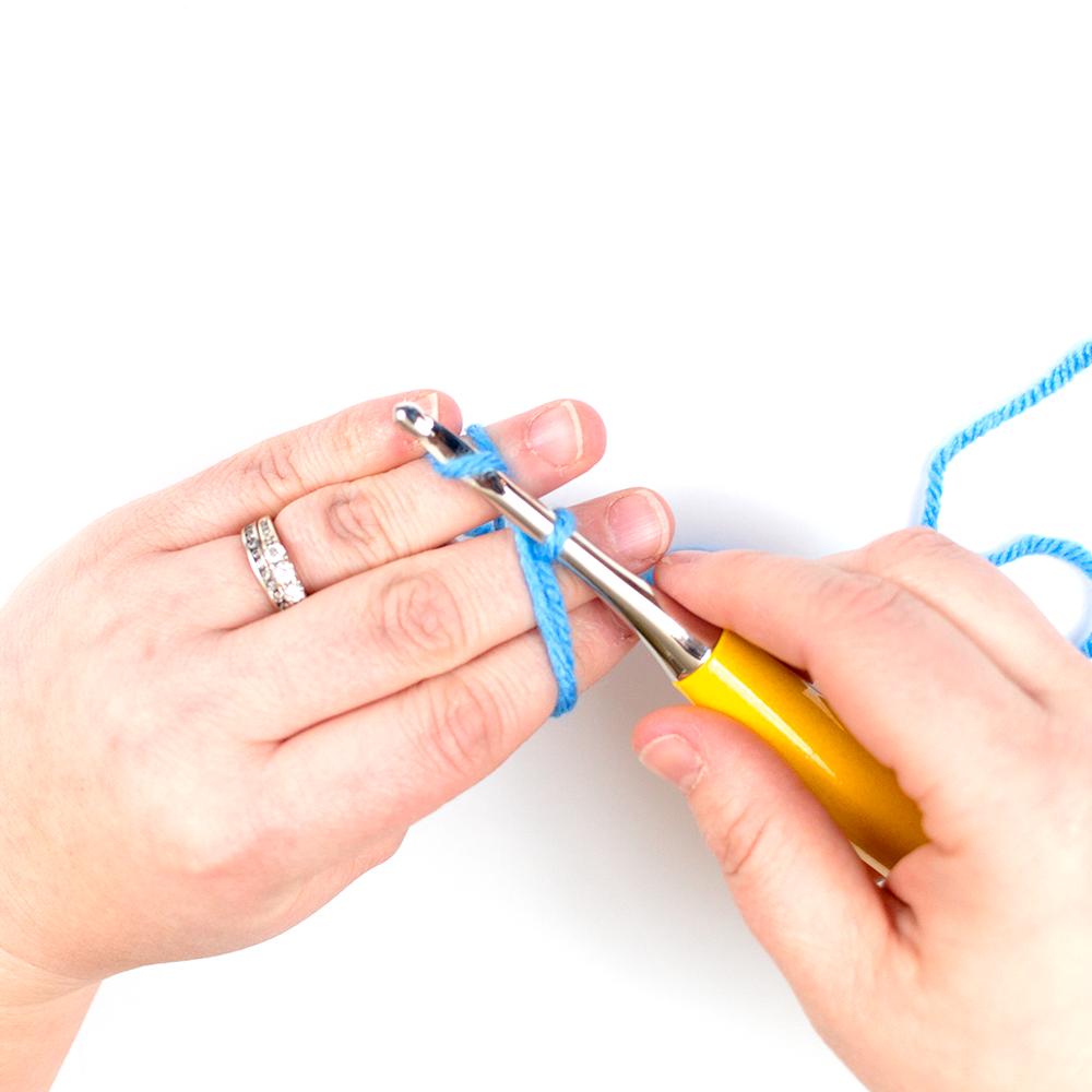 Yarn over crochet hook to create a chain