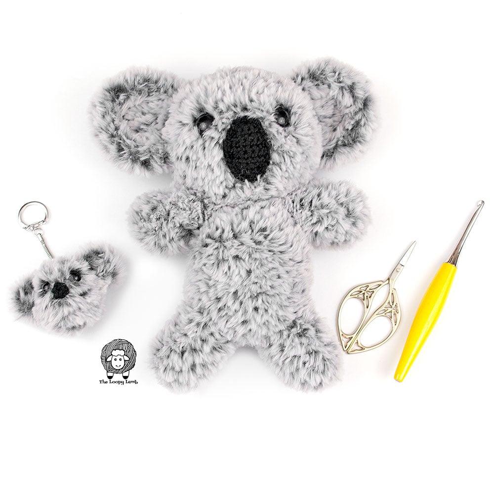 Crochet Koala Keychain and Amigurumi Koala next to crochet accessories