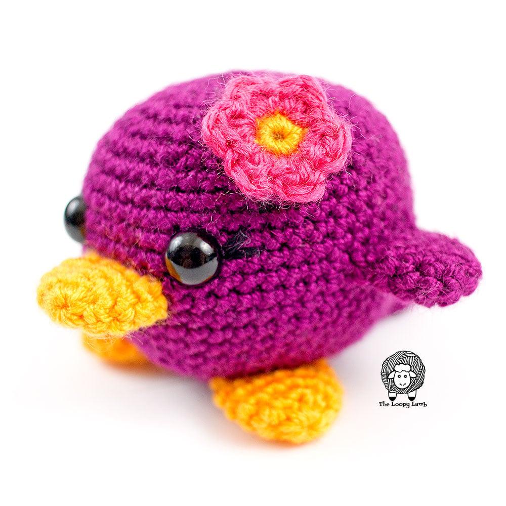 Purple crochet bird made with this free crochet bird pattern