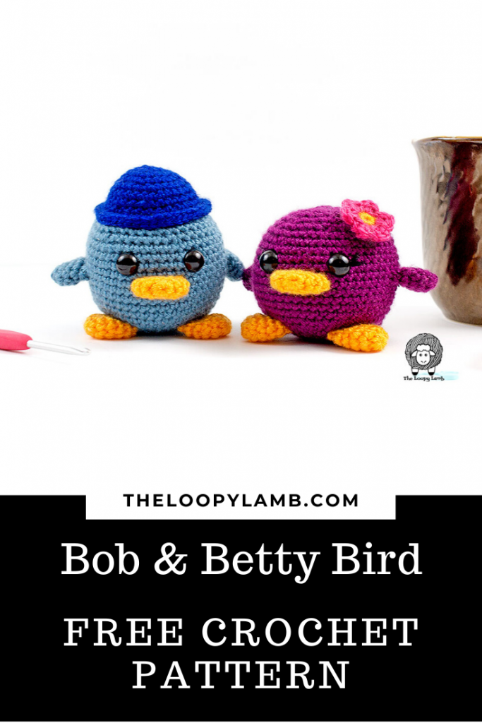 Two chubby crochet birds, one wearing a hat and one with a flower on her head, made with this free crochet bird pattern