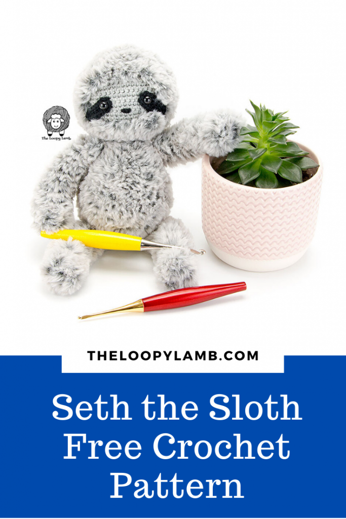 Amigurumi Crochet Sloth made with Faux fur holding a crochet hook