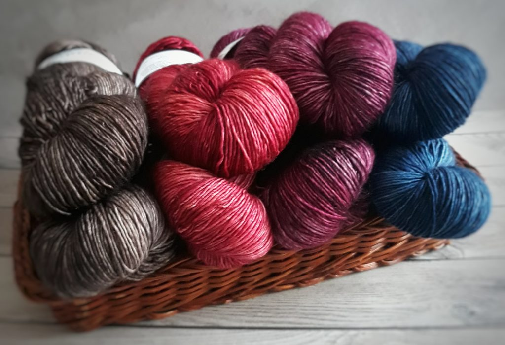Hand dyed yarn in a basket from crocheter's yarn stash