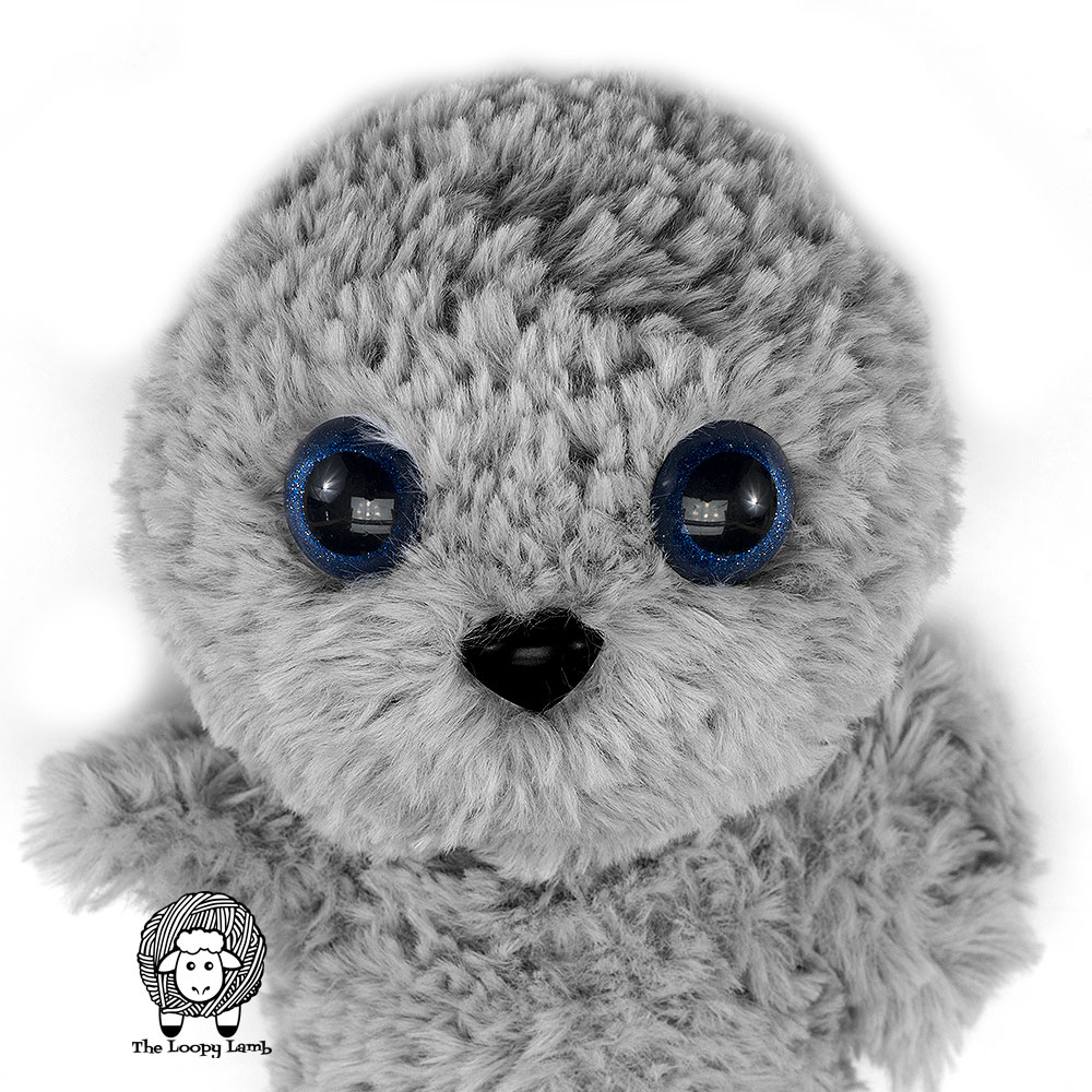 close up image of the face of the amigurumi seal made with this free pattern