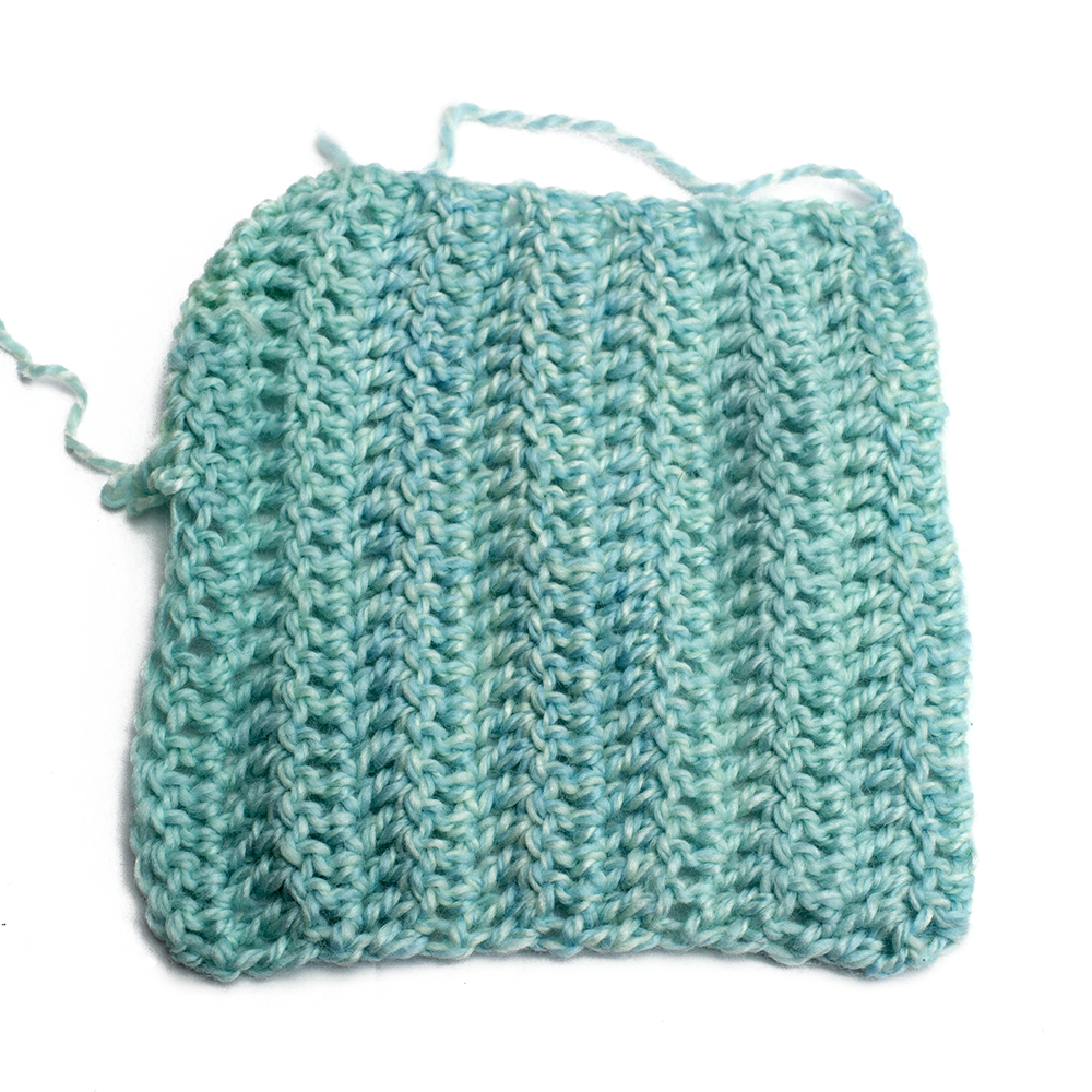 Crochet Swatch of Chroma Twist Worsted Weight in Narwal
