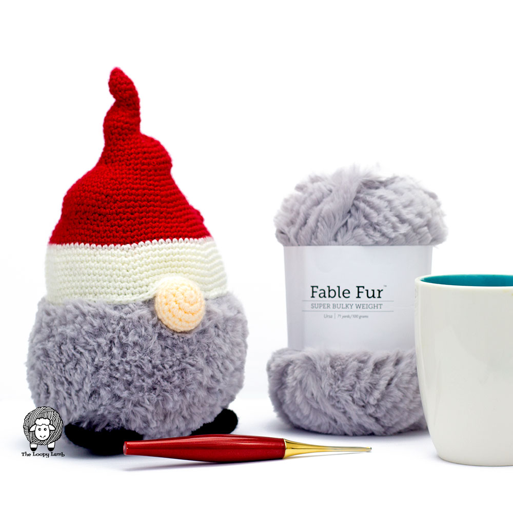 Crochet Christmas Gnome with a furls crochet hook and a skein of fable fur yarn