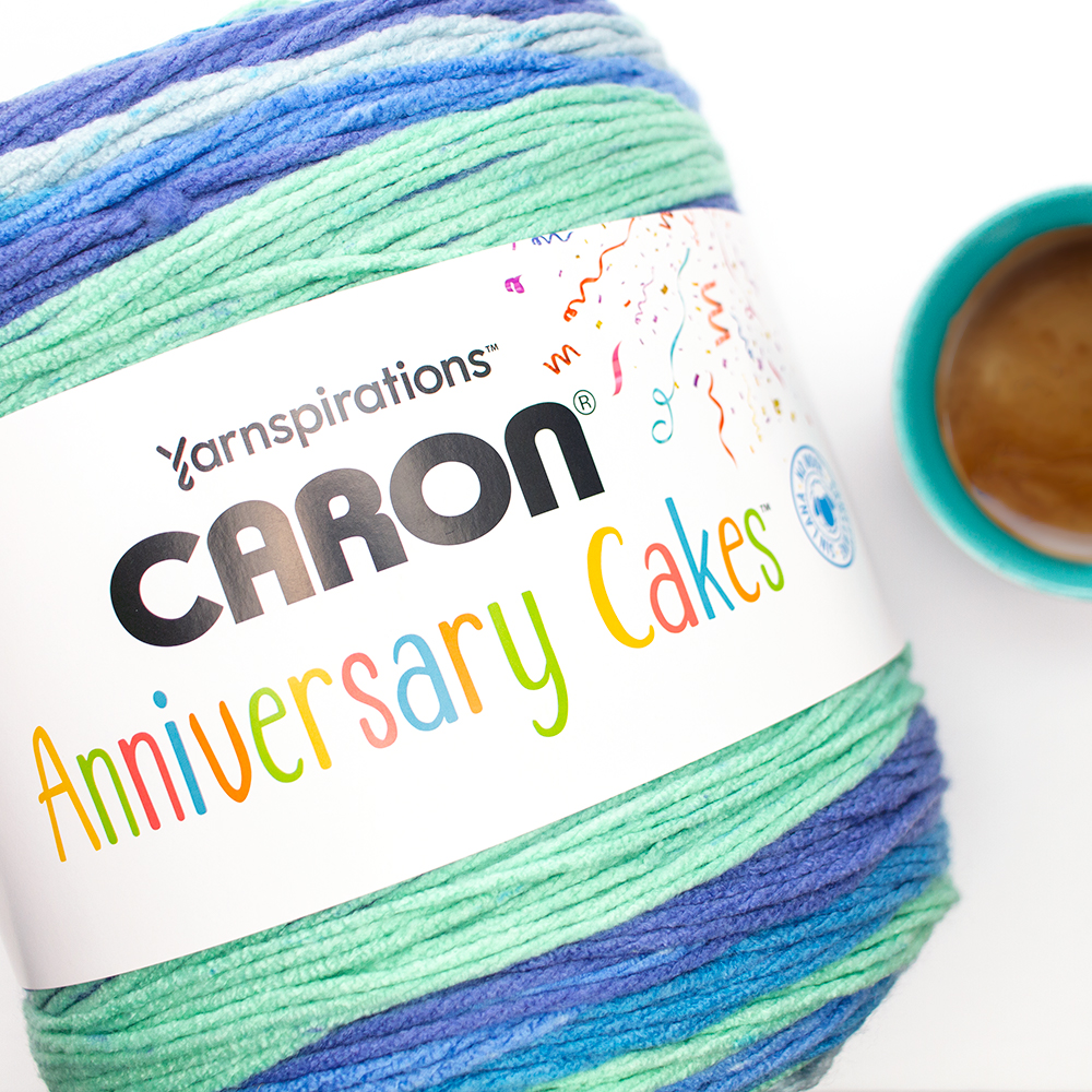 Caron Anniversary Cakes in Blueberry Birthday next to a coffee mug to show the size difference.