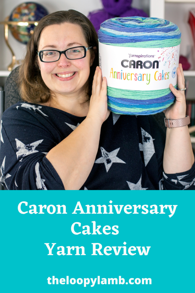 Picture of a smiling woman holding a Caron Anniversary Cake