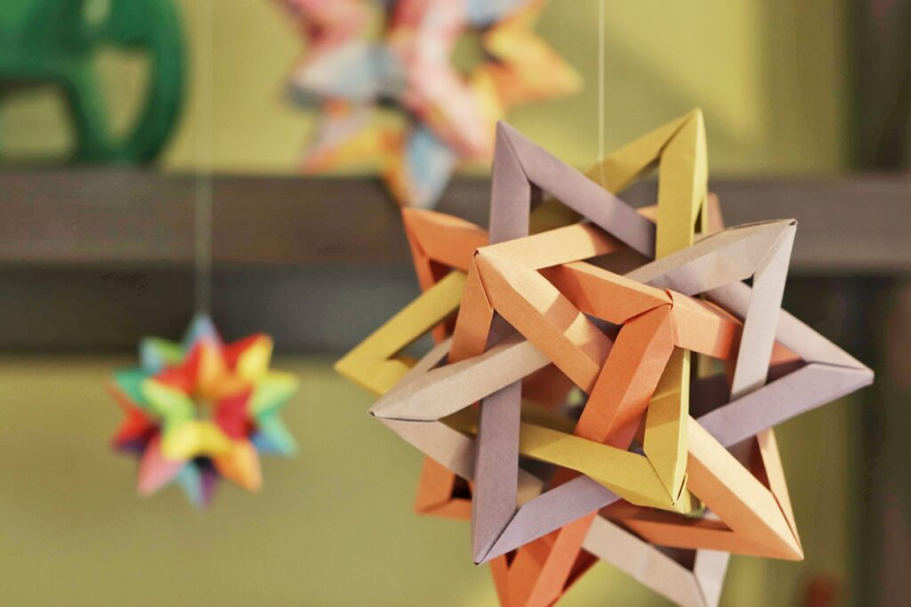 Origami stars hanging from string made by Julia Chiang of Craftings of Joules