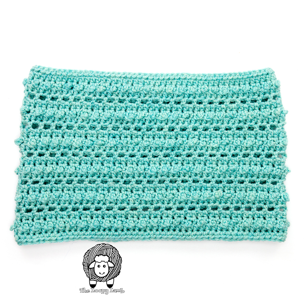 flat lay image of crochet cowl with a bobble texture made using picot single crochet stitch.