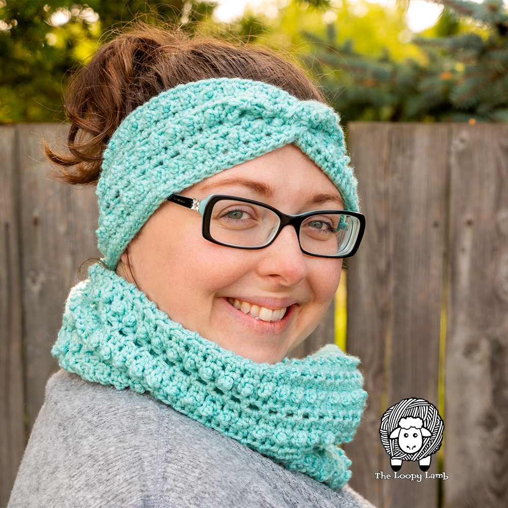 """""""Smiling woman wearing the Picot Single Crochet Stitch Ear Warmer and Cowl Set"""