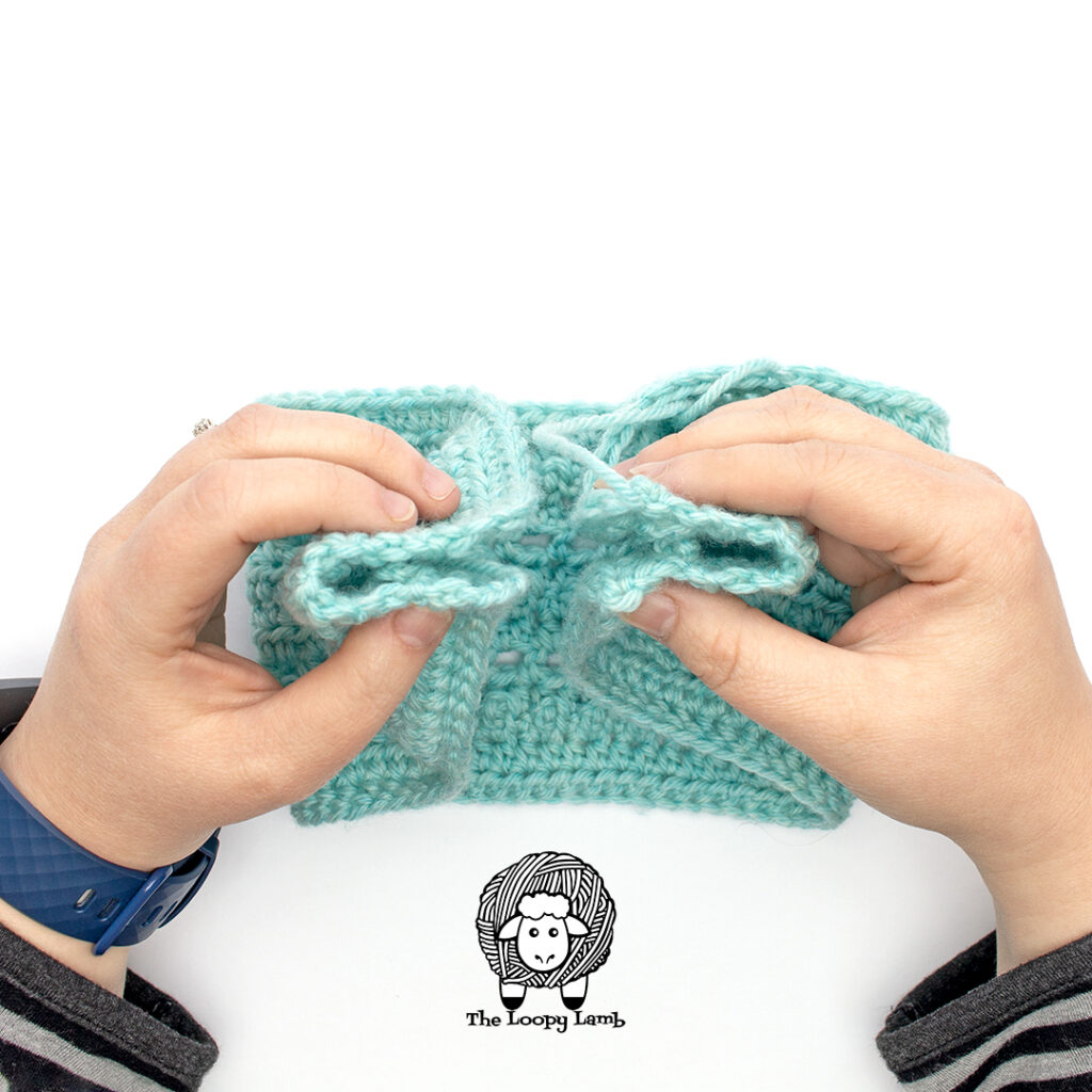 Step one of closing up the crochet ear warmer