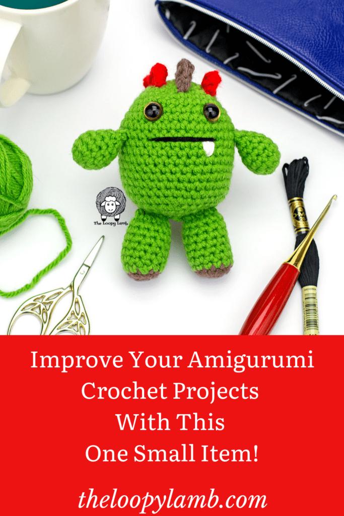 green monster amigurumi crochet project with crochet accessories