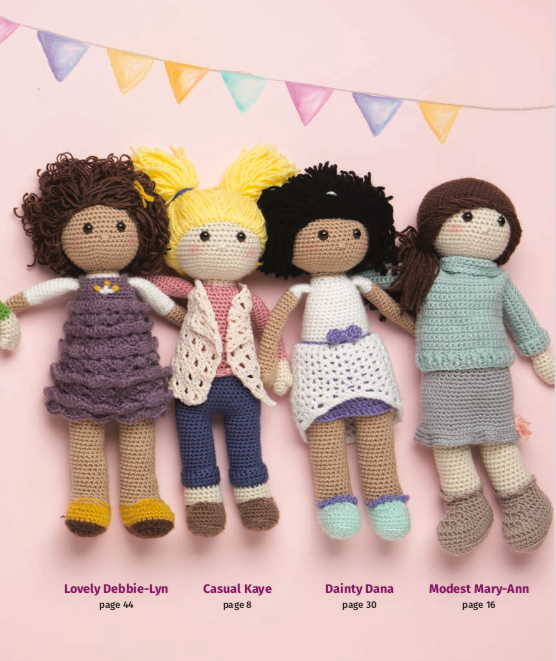 crochet dolls in a flay lay, made from the patterns in Besties: Every Girl Needs a Friend