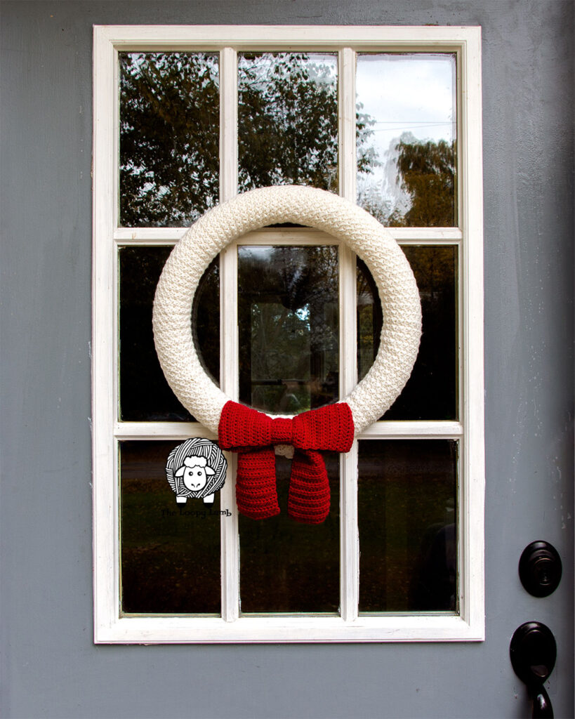 easy christmas wreath on a grey and white door.