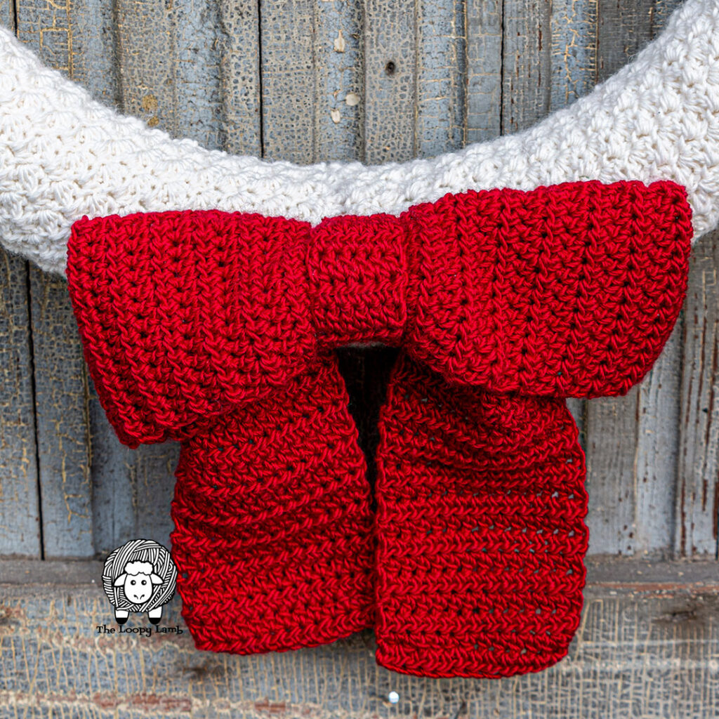 Large red crochet bow close up image