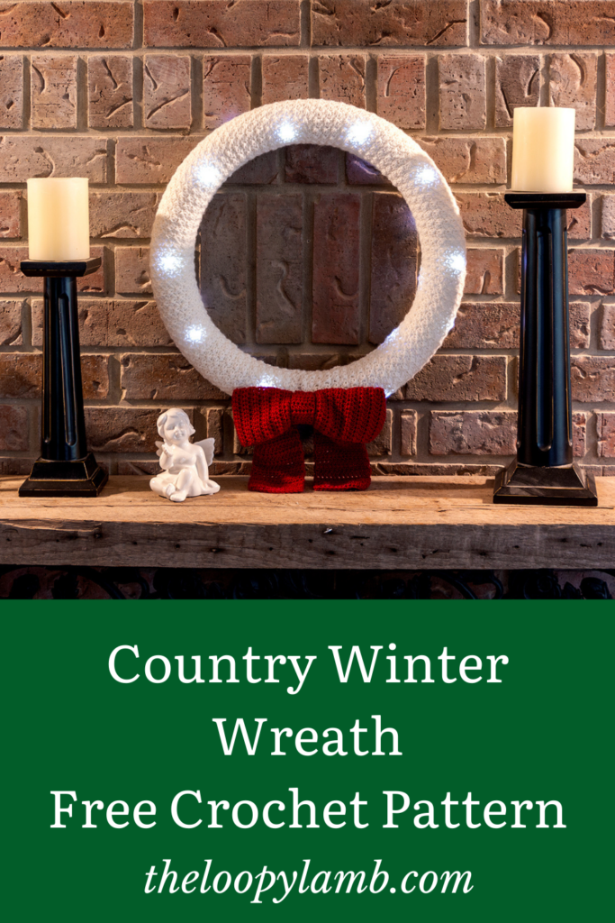 Crochet wreath with lights hanging on a fireplace mantel.