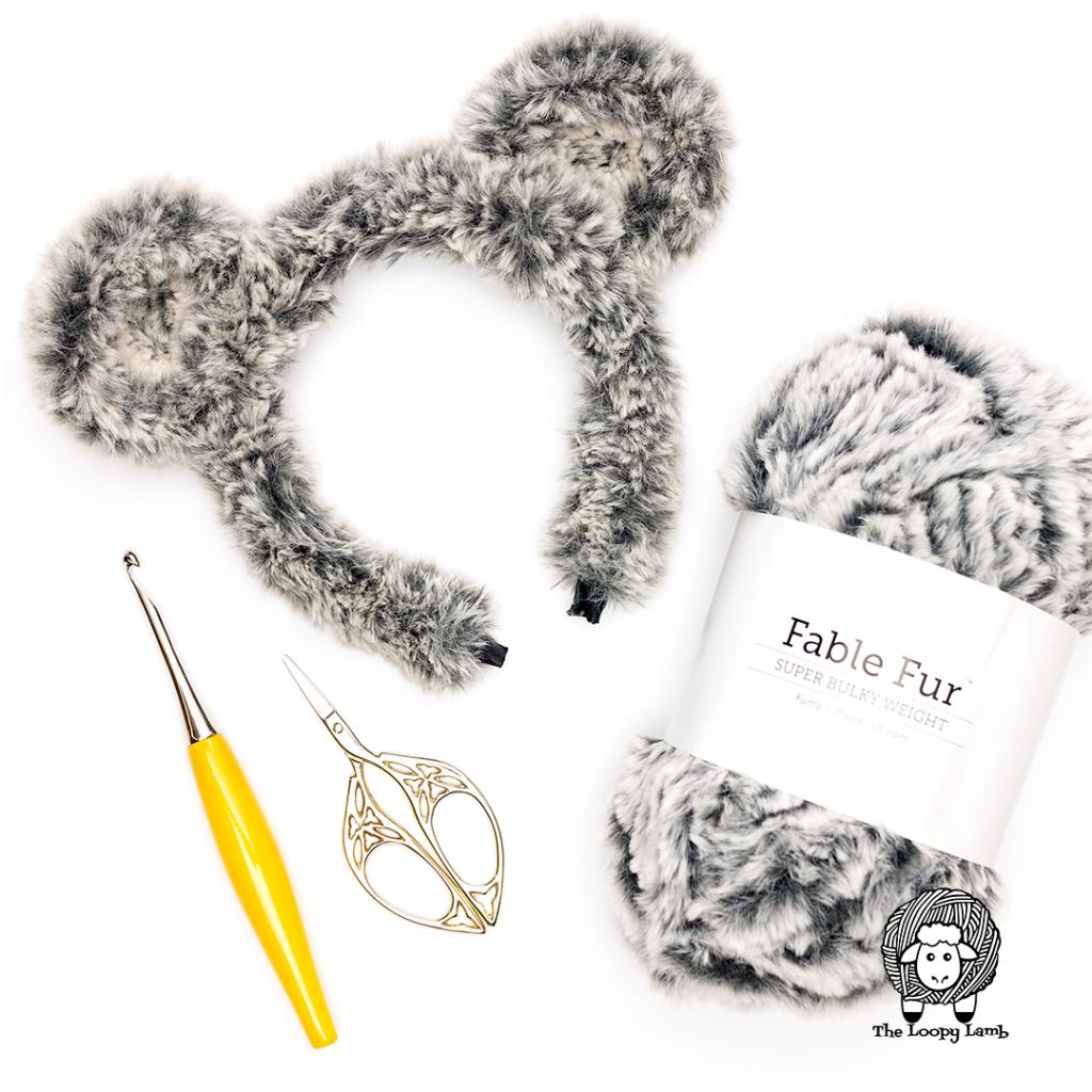 crochet bear ears in a flat lay with We Crochet Fable Fur and a Furls Odyssey Crochet Hook