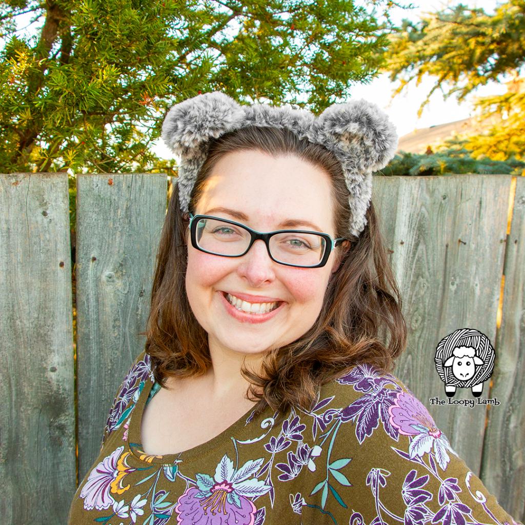 Smiling woman wearing faux fur crochet bear ears