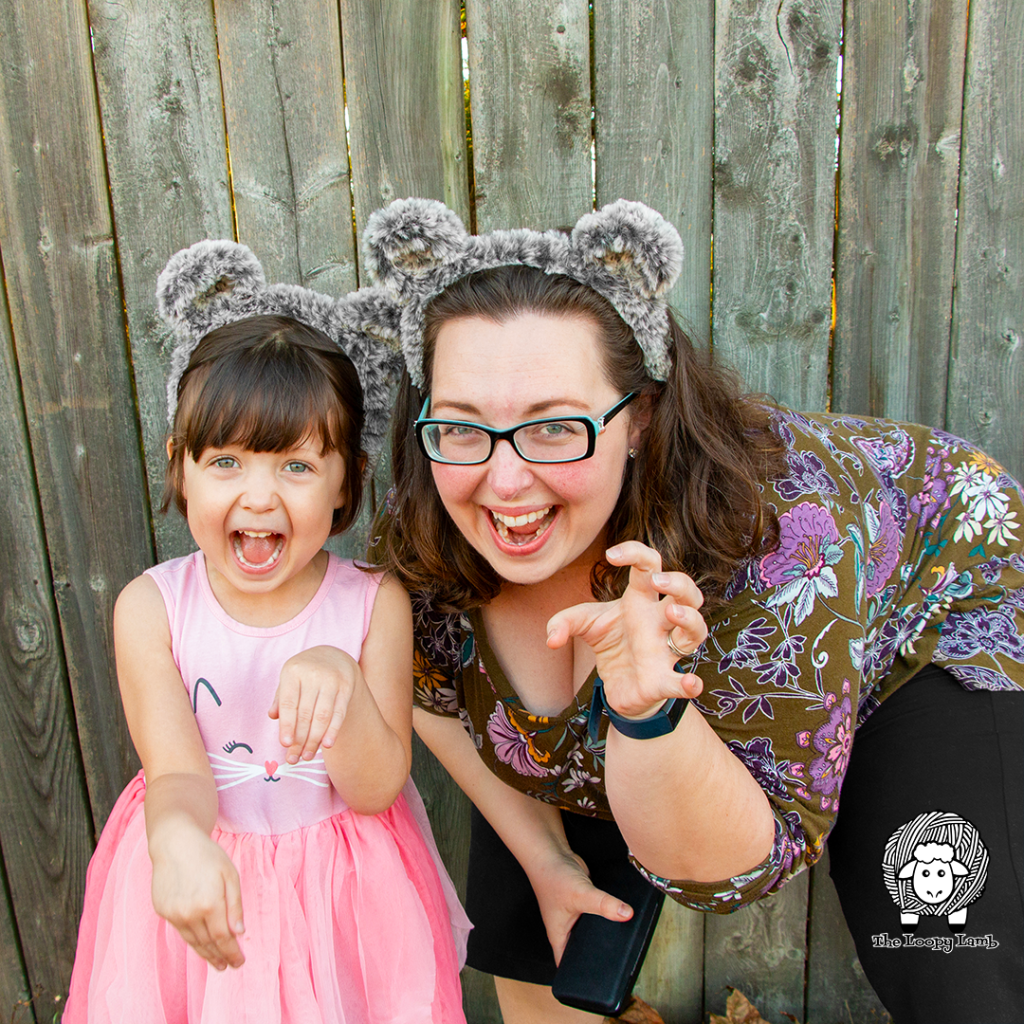 Mother and daughter pretending to be bears while wearing crochet bear ears