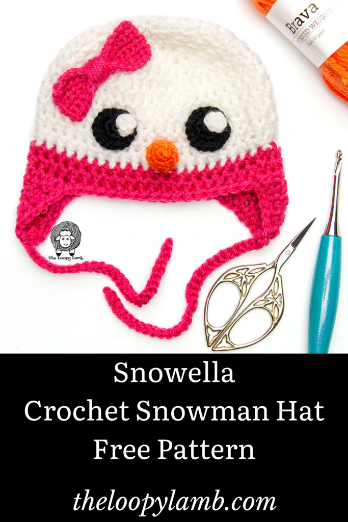 Crochet snowman hat in a flat lay