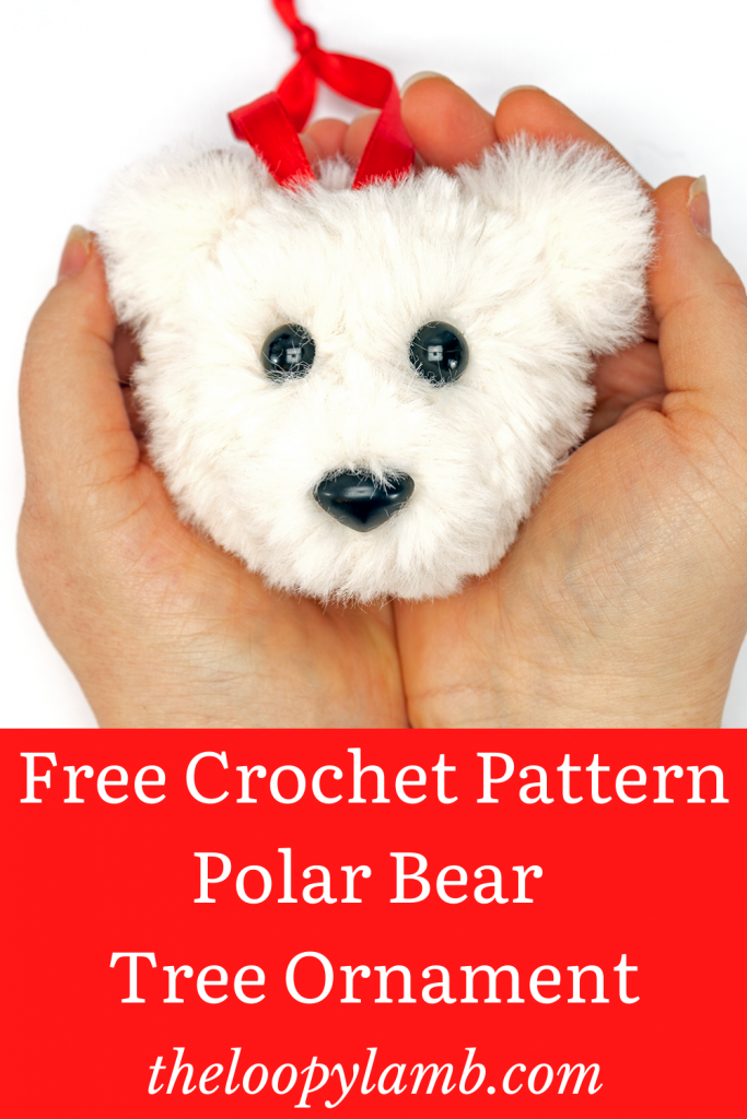 Crochet bear ornament held in cupped hands.
