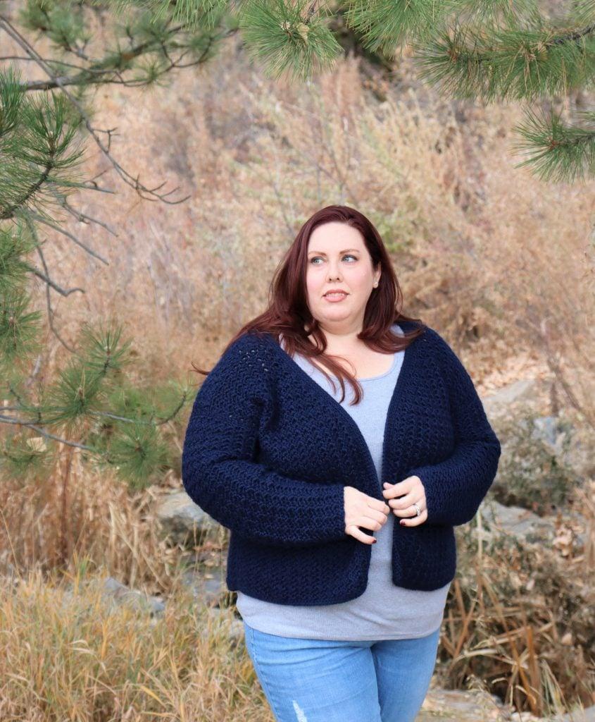 Plus size woman wearing a crochet cardigan