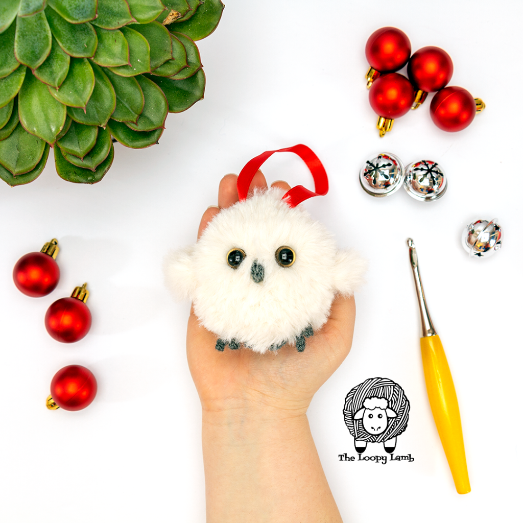 Crochet Owl Ornament Free Pattern sample in a cupped hand