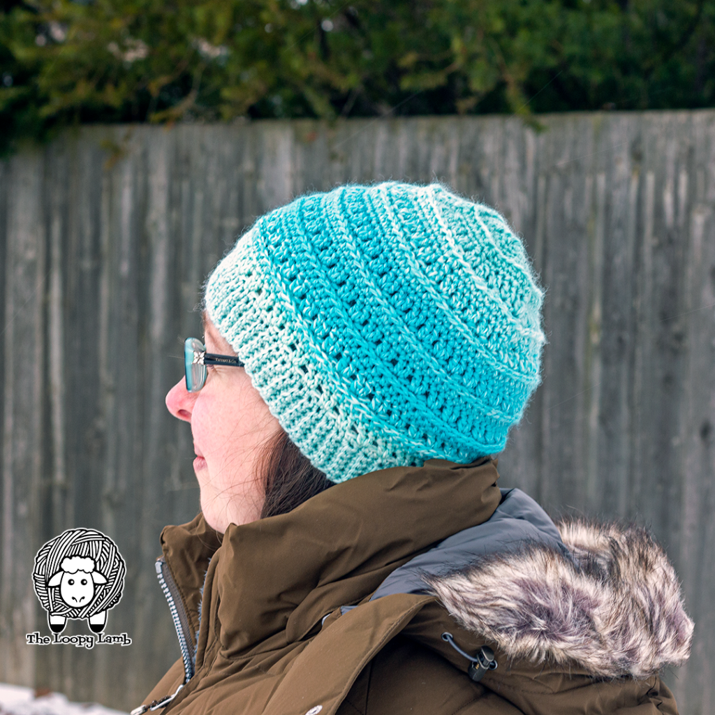 Woman modelling the hat made with this One Skein Crochet Hat Pattern in Narwhal