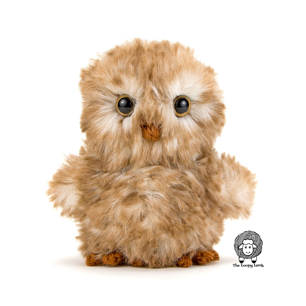 amigurumi owl made with faux fur yarn and a free pattern found on this blog