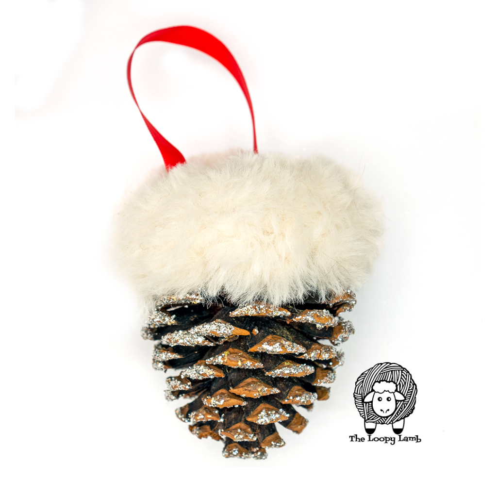 Pinecone topped with fur to look like snow made with this Free Crochet Christmas Ornament Pattern