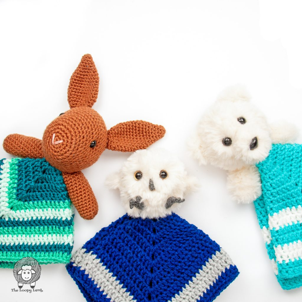 three different crochet loveys in a flat lay