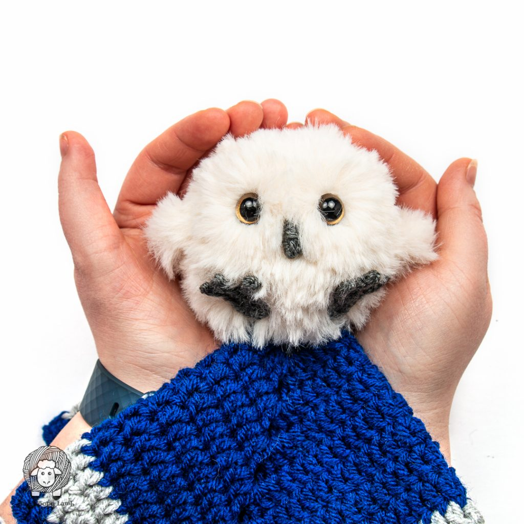 crochet owl made with faux fur cupped in hands