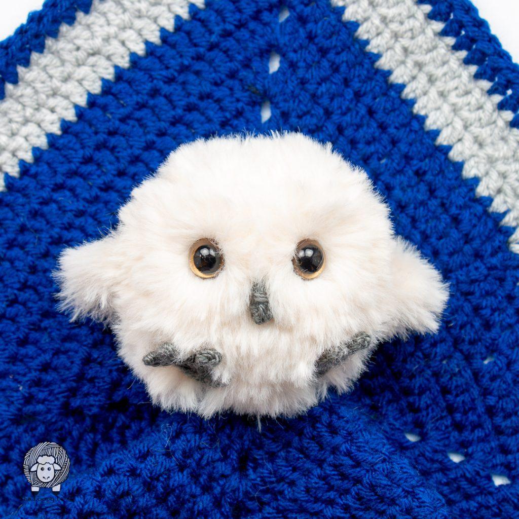baby crochet owl on a blue crochet security blanket
